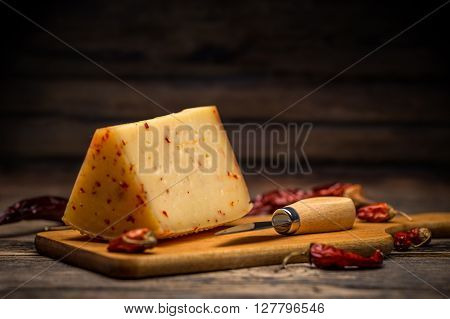 Aging artisan cheese flavoured with chilli, studio shot