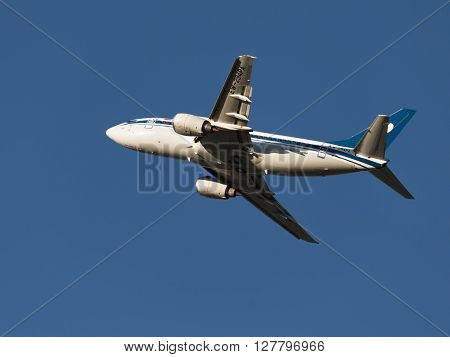 Moscow - August 20 2015: A passenger plane Boeing 737-505 Belavia Belarusian Airlines International Airlines flies to Domodedovo airport and the blue sky August 20 2015 Moscow Russia