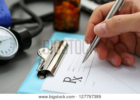 Male Medicine Doctor Hand Write Prescription To Patient