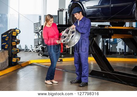 Mechanic Showing Alloy To Customer