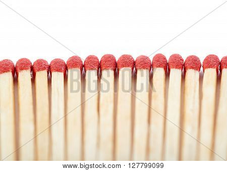 Pile of Wooden unused matches isolated over the white background