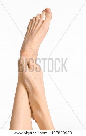 Pedicure And Foot Care Topic: The Naked Man's Legs Isolated On White Background In Studio