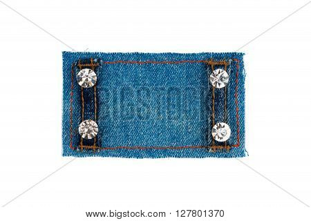 Frame with two straps jeans and rhinestones isolated on white background with space for your text