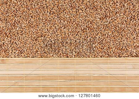 Wheat grain and bamboo mat with place for your text