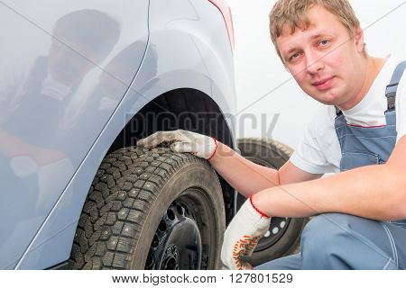 Portrait Of A Mechanic Near The Car In The Garage