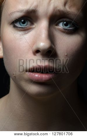 Violence And Abuse Of Girls Theme: Portrait Of A Beautiful Young Girl With Tears In Her Eyes, A Beau