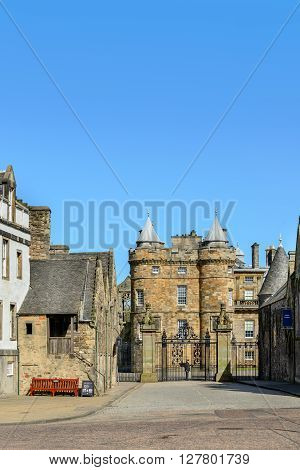 EDINBURGH SCOTLAND - APRIL 27 2016: Entrance gates to the Palace of Holyroodhouse in Edinburgh from the Canongate.