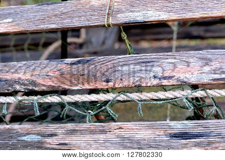 Close up detail of weathered wood on antique wooden lobster crate.