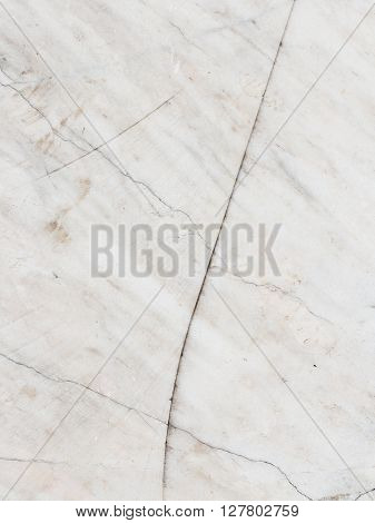 old uneven light gray marble and white with blond streaks and spots