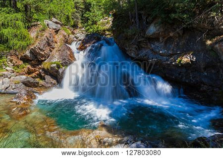 Creek Waterfall In The Forest