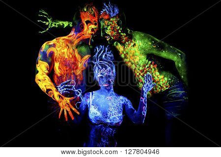 Fire, Land and Air. Body art glowing in ultraviolet light, four elements, isolated on black background