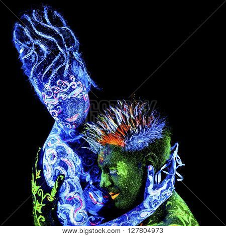 Land Loves Air. Body art glowing in ultraviolet light, four elements, isolated on black background