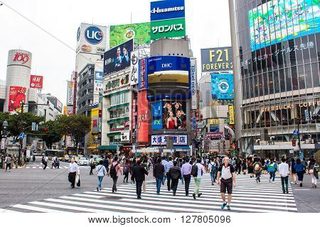 TOKYO JAPAN - OCTOBER 10 2015 - Shibuya Crossing One of the world's most used pedestrian scrambles at Hachiko Square in Shibuya special ward.
