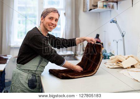 Man In The Workshop. Fur Working