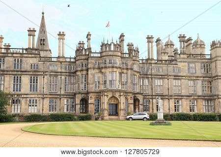 STAMFORD, ENGLAND - JUNE 14, 2014: Burghley House on June 14, 2014 in Stamford, England. It is a landmark medieval castle in Central England.