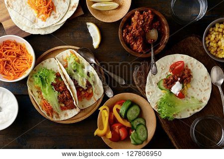 Mexican Tacos With Ground Beef And Pork, Carrots, Cucumber, Corn, Pepper, Tomato, Lettuce