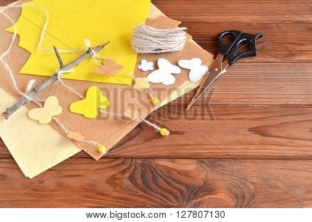 Felt butterfly and flower on a branch, sheets of felt, scissors. Decorative panels for wall