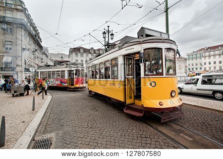 Lisbon Portugal - October 19 2012: Streetview of the Famous Old Yellow Tram on Romantic typical street of Lisbon Portugal.