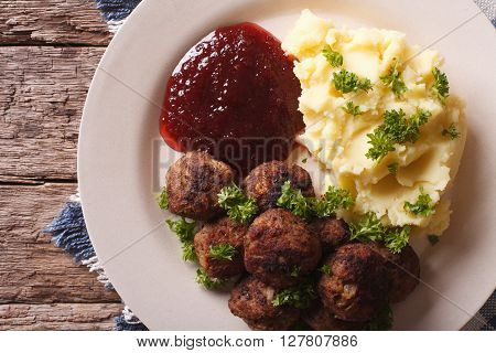 Swedish Cuisine: Meatballs, Lingonberry Sauce, Potato Closeup. Horizontal Top View