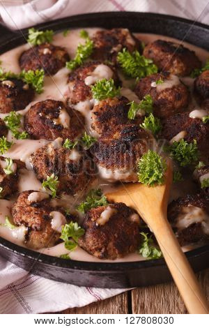 Swedish Meatballs In A Creamy Cowberry Sauce Closeup On A Pan. Vertical