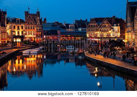 Medieval old part of the famous Flemish city Ghent, Belgium which is held well preserved. It is a busy city which hosts many students and tourists spending the night outside