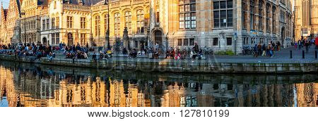 GHENT, BELGIUM - MARCH 6, 2014: Medieval old part of the famous Flemish city which is held well preserved. It is a busy city which hosts many students and tourists spending the night outside