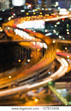 Blurred bokeh light, closed up highway intersection and curved, night view