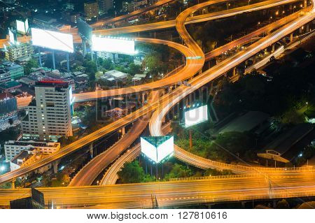 Aerial view night lights over highway interchanged