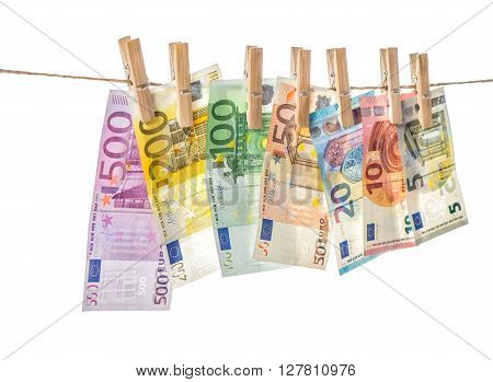 Money background. Euro banknotes hanging a rope with clothes pins. Selective focus
