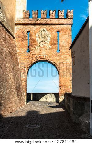 Barolo, Cuneo, Italy, Europe - March 20, 2016 : View of the arc at the entrance of the Barolo Castle