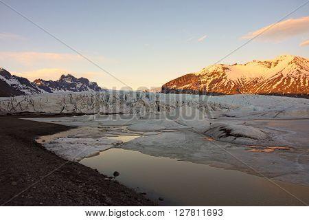 Glacier lake in front of Mýrdalsjökull glacier in Iceland at sunset