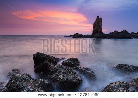 Rocky seacoast long exposure with dramatic sky after sunset