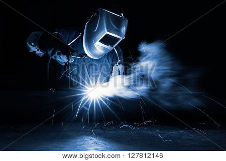 Closeup industrial Worker at the factory welding