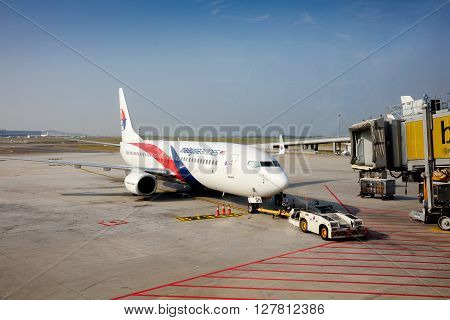 KUALA LUMPUR - April 14 2016: view of Malaysia Airlines plane activity in Kuala Lumpur International Airport & plane take off in the background on April 14 2016 in Kuala Lumpur Malaysia.