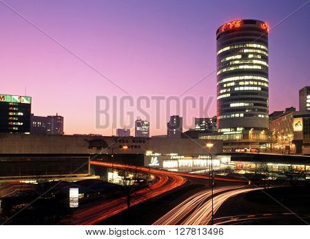 BIRMINGHAM, UNITED KINGDOM - JANUARY 11, 1993 - View of the Rotunda and Bull Ring at sunset Birmingham West Midlands England UK Western Europe, January 11, 1993.