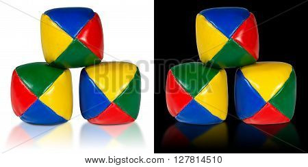 Used and colorful juggle balls isolated on white and black background with reflections