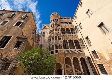VENEZIA, ITALY - SEPTEMBER 13, 2015: The Scala Contarini del Bovolo of Contarini Palace in the city of Venezia (UNESCO world heritage site), Veneto, Italy