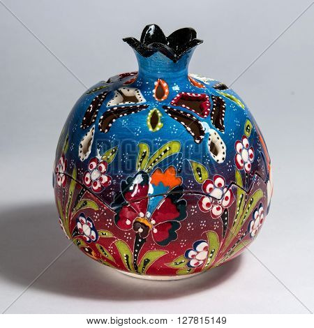Souvenir ceramic candle lamp spherical shape in the form of a pomegranate.