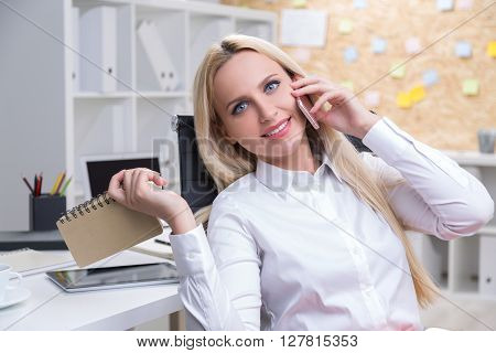 On Phone With Notepad