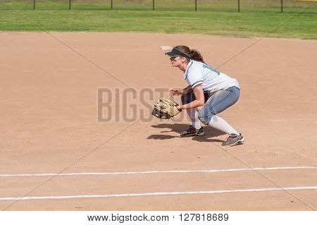 First baseman crouched and ready for action.