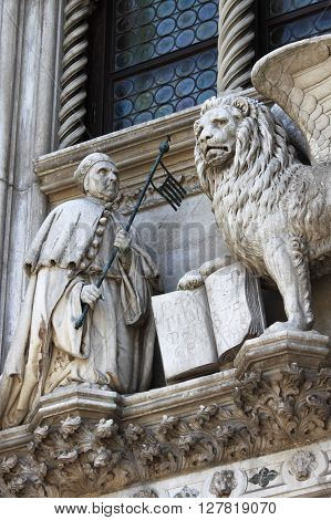The winged lion and the doge Francesco Foscari on the Doge Palace in Venice, Italy