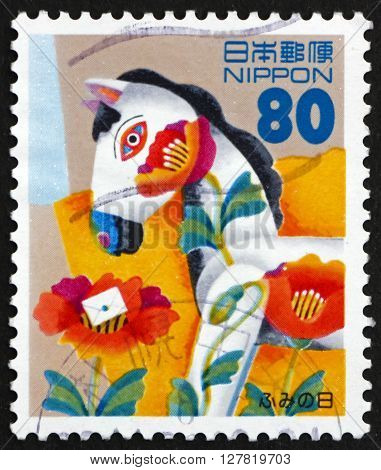 JAPAN - CIRCA 1996: a stamp printed in the Japan shows Horse Toy Child's Drawing Letter Writing Day circa 1996