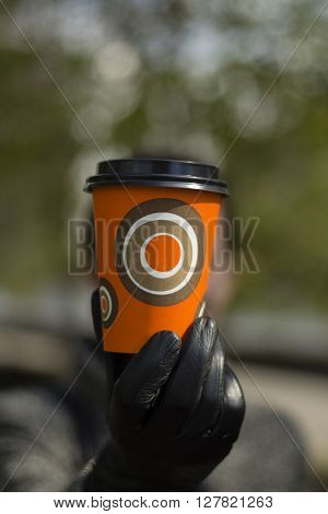 Enjoy Your Drinks. Coffee shop worker two disposable cups with blank sleeves