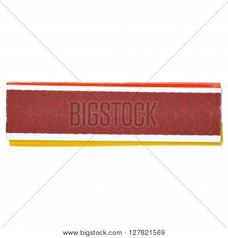 Unused striking surface box side of matches isolated over the white background