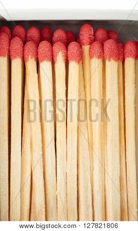 Pile of Wooden unused matches in box isolated over the white background