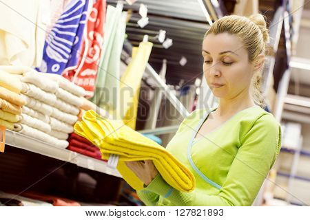 Woman choosing towels in a mega store