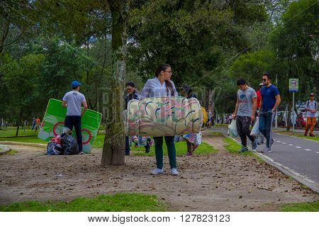 Quito, Ecuador - April, 17, 2016: Unidentified citizens of Quito donating disaster relief items, food, clothes, medicine and water for earthquake survivors in the coast.
