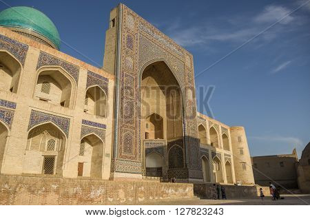 Decorated With Traditional Ornament Facade Of Mir-i Arab Madrasah In Sunset, Historic Centre Of Bukh