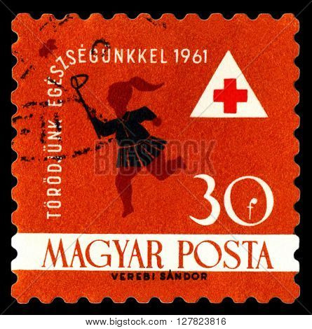 STAVROPOL RUSSIA - APRIL 05 2016: a stamp printed in Hungary shows Child Chasing Butterfly Red Cross circa 1961.