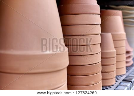 Stack of Clay pots on a shelf with shallow depth of field
